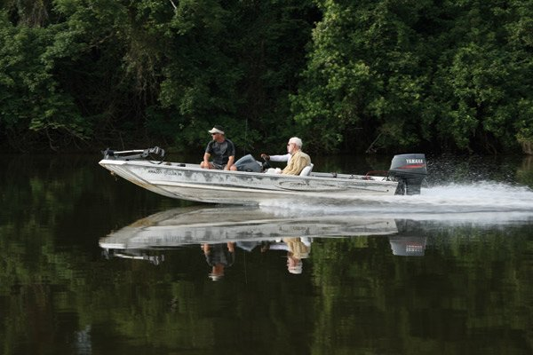 Photo of two anglers boating on the Amazon River