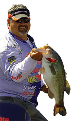 Photo of pro angler Peter Thliveros holding a bass