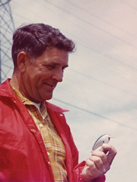 Photo of Bill Nichols holding a 'Big O' fishing lure