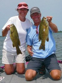 Photo of Kerry and Kevin Short with a pair of smallmouth bass from Lake Michigan