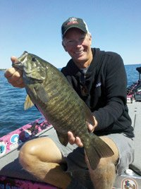 Photo of Kevin Short with a smallmouth caught on Lake Ontario