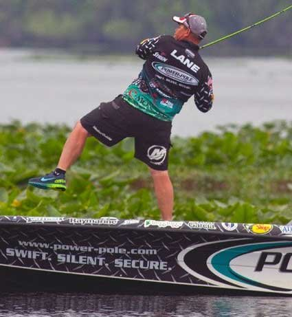 Photo of Chris Lane reeling in a bass