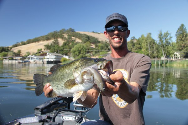 Photo of angler Paul Nailey holding a bass
