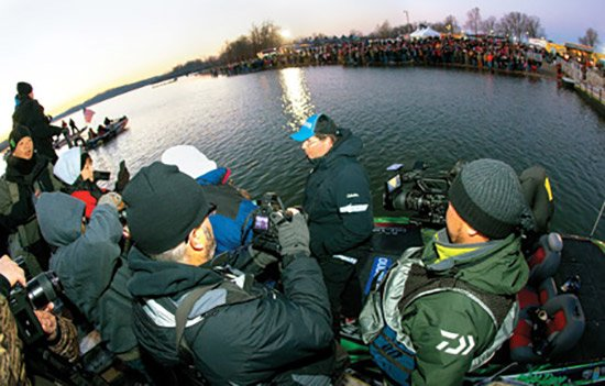 Photo of 2013 Bassmaster Classic winner Cliff Pace talking with the media