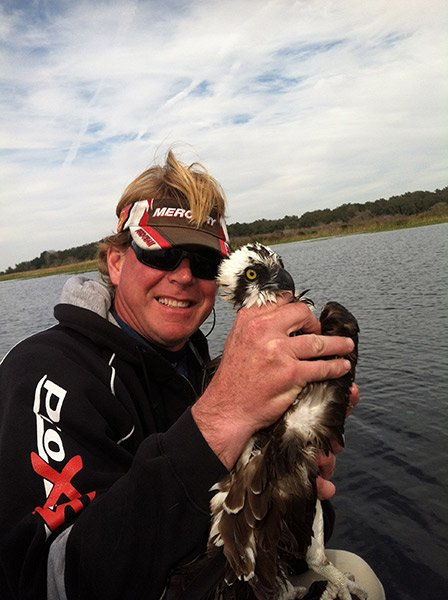 Photo of a Bassmaster Pro Rick Morris holding an osprey