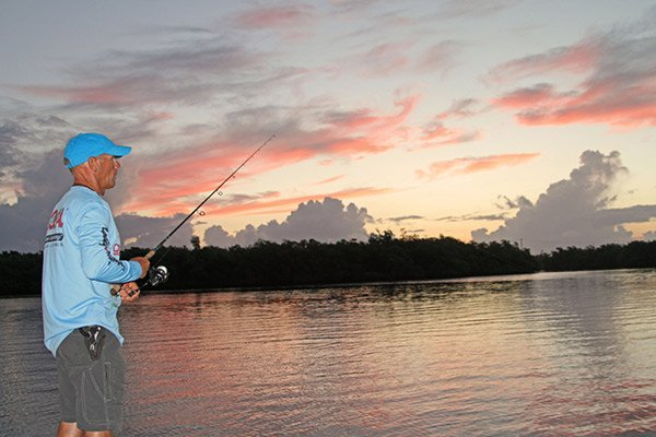 Photo of a fisherman at sunrise on the Florida flats
