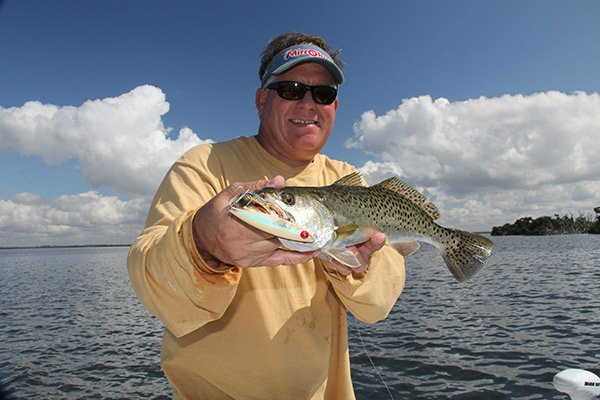 Photo of an angler with a redfish caught while fishing the Florida flats