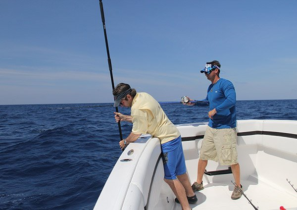 Photo of two men fishing for King Mackerel