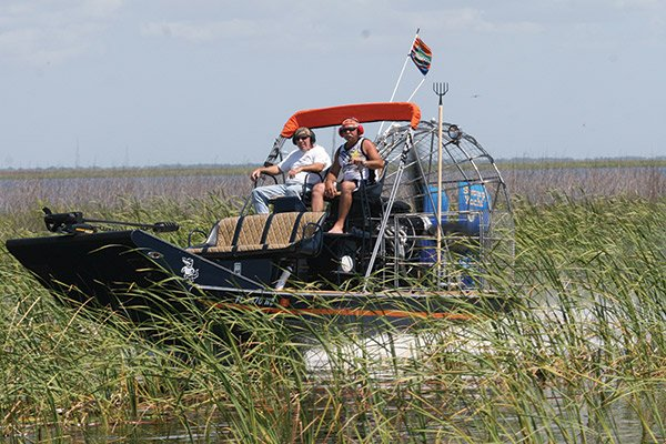 Photo of two men on an airboat on Lake Okeechobee