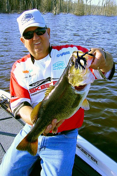 Photo of Lonnie Stanley with a bass catch