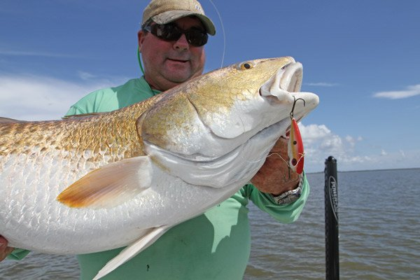 Photo of Mike Frenette and his 50 lb. redfish