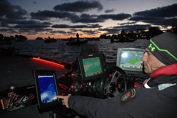 Photo of Jamey Caldwell fishing using his computer research