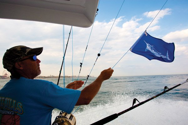 Photo of an angler putting out the white marlin flag