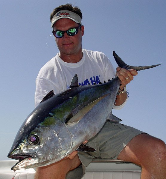 Photo of an angler with an Almaco Jack