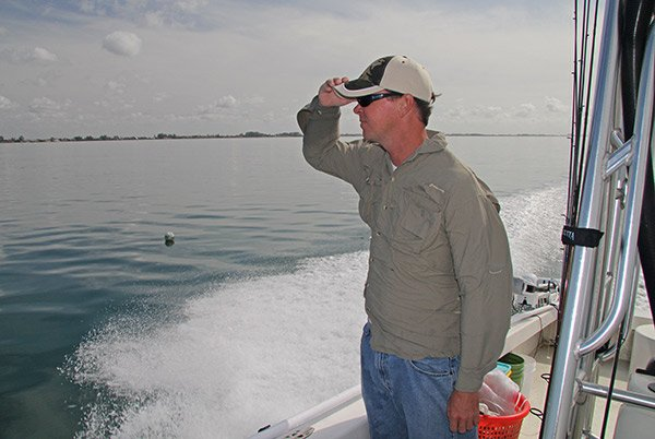 Photo of a fisherman looking for tripletail