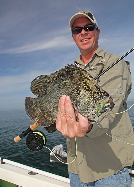 Photo of Jonny Keyes catching a tripletail