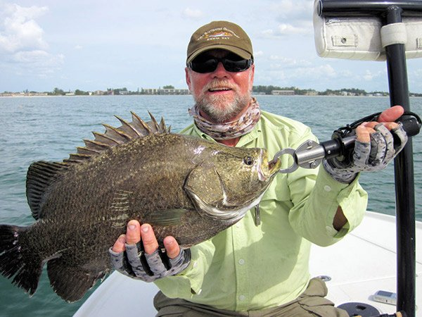 Photo of Capt. Rick Grassett with a tripletail