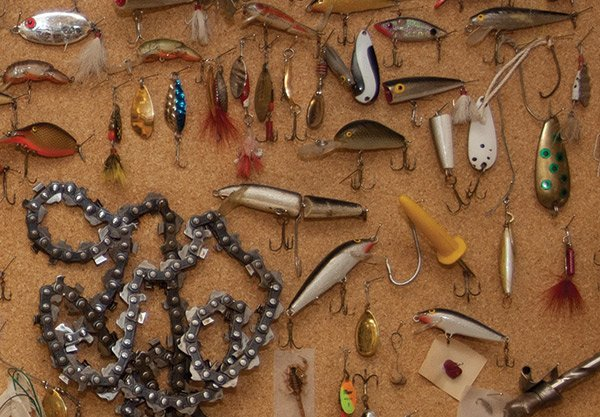 Photo of a chainsaw chain and fishing lures