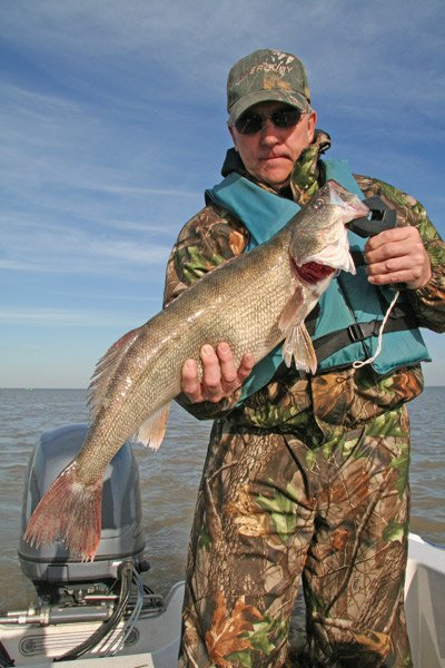 Photo of a man holding a walleye