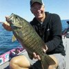 Thumbnail photo of Kevin Short with a Lake Ontarion smallmouth bass