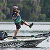 Thumbnail photo of Chris Lane reeling in a bass on the St. Johns River