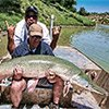 Thumbnail photo of Mark Zona and Tommy Sanders with an alligator gar