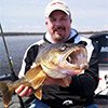 Thumbnail photo of Capt Steve Paulsen with a Green Bay walleye