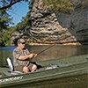 Thumbnail photo of Ron Duncan fishing from his boat