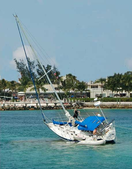 Photo of a sailboat run aground on reef