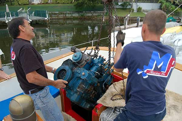 Photo of working ona boat engine