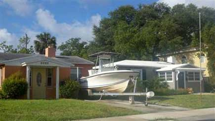 Photo of boat and trailer parked in front of a home.jpg