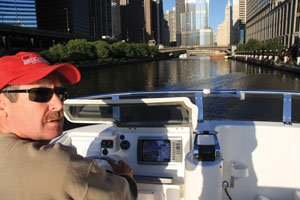 photo of Jim Favors navigating the Chicago River