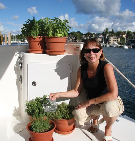 photo of Lisa Favors tending to the herbs on her boat