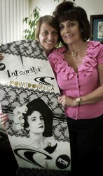 photo of Jen GilanFarr and her grandmother with a GMA board