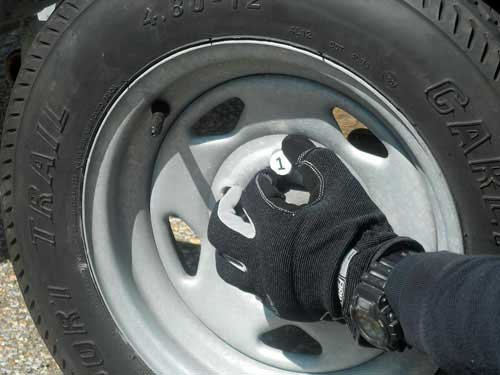 Photo of hand tightening tire lug nuts