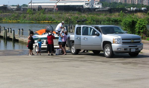 photo of a family loading their boat at the ramp