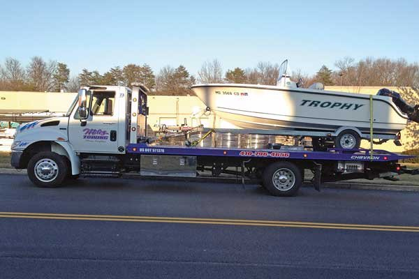 Photo of TRAILER ASSIST Tower Miles Towing towing a boat