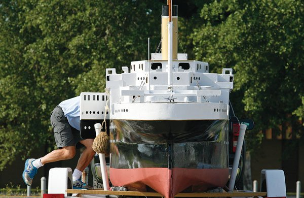 Photo of Mark Koch repairing the Titanic replica