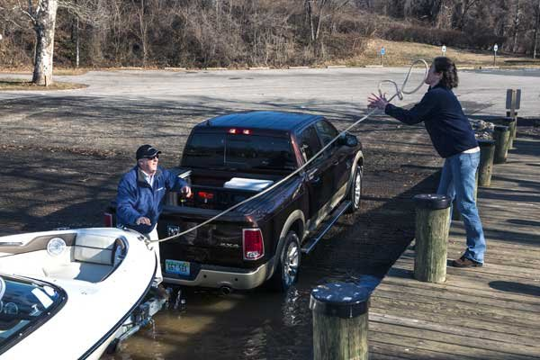 Photo of trailer and boat at a boat ramp