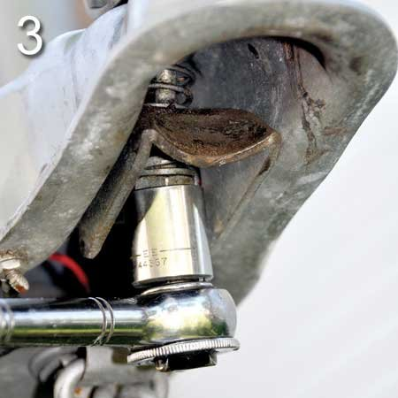Photo of wrench fitting over nut