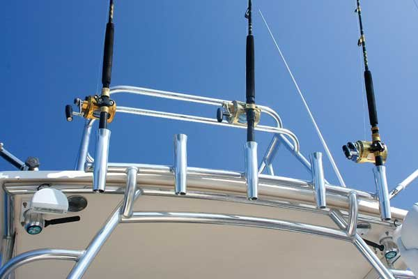 Photo of rigged rods in a vertical position on a fishing boat