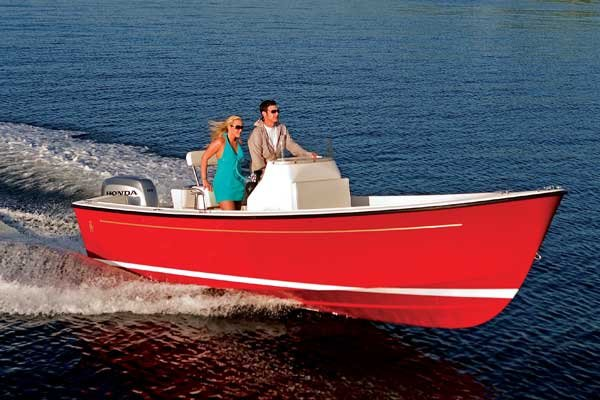 Photo of a young couple on the water in a powerboat