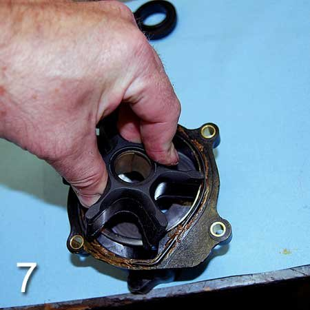 Photo of pushing impeller into the housing liner with a slight clockwise twist
