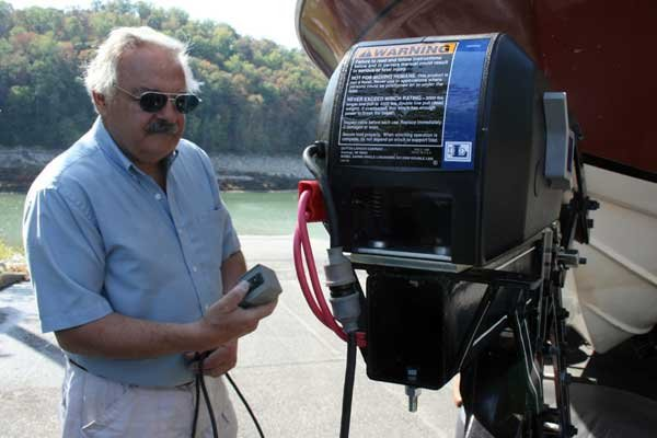 Photo of author with his new electric winch and remote