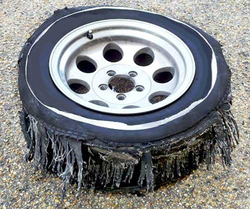 Photo of a shredded tire