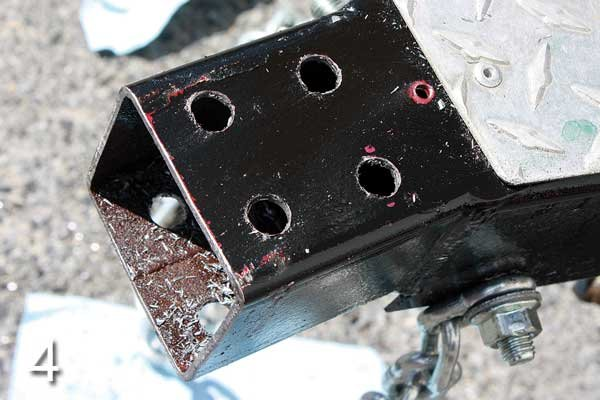 Photo of holes for hitch bolts have been drilled