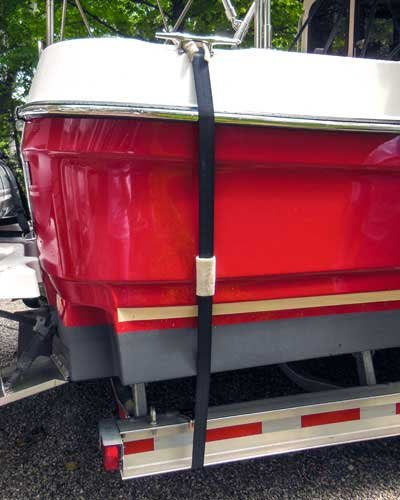 Photo of a taut safety strap mounted from a boat's bow straight down to the trailer