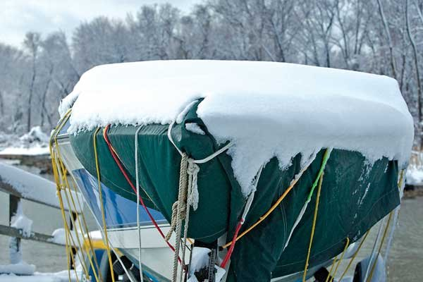 Photo of snow on top of a boat cover