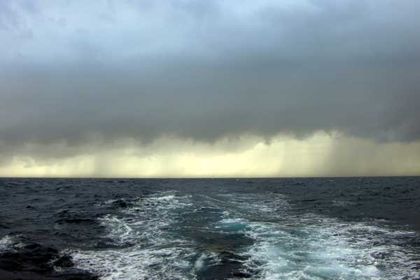 Photo of a storm over open water
