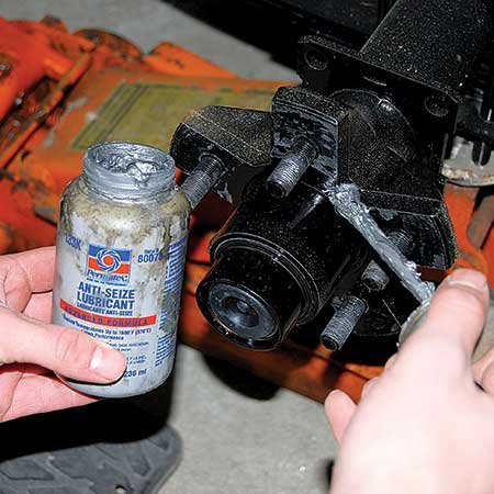 Photo of applying anti-seize lubricate